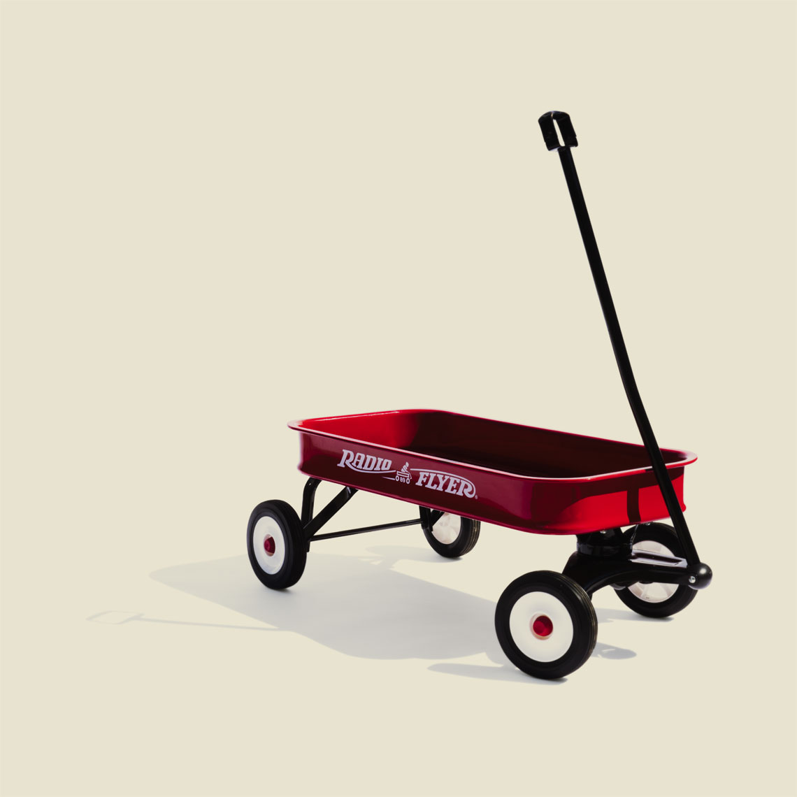 Still Life, Editorial, Advertising and Corporate Studio Photography Jacksonville, Florida  Conceptual Radio Flyer Portrait
