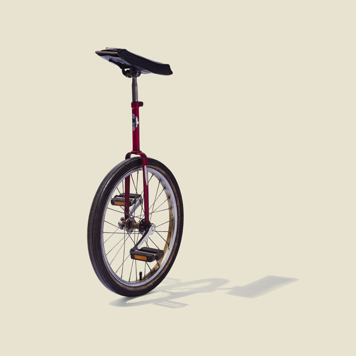 Still Life, Editorial, Advertising and Corporate Studio Photography Jacksonville, Florida  Conceptual Unicycle bike Portrait